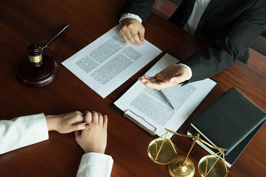 Lawyer Working With Contract Client
