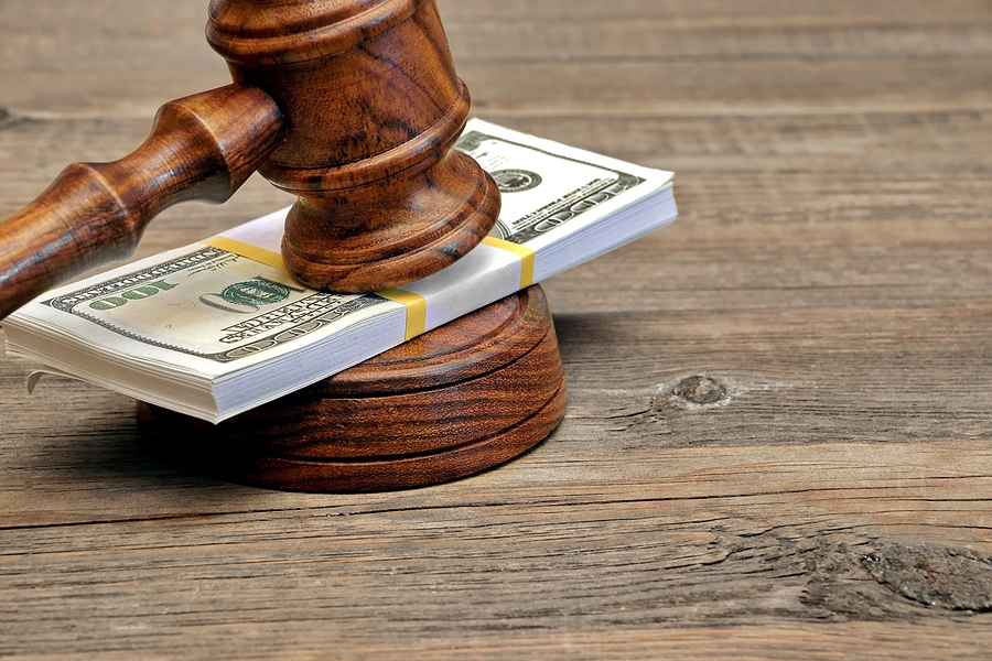 Money and gavel because of a garnishment bond